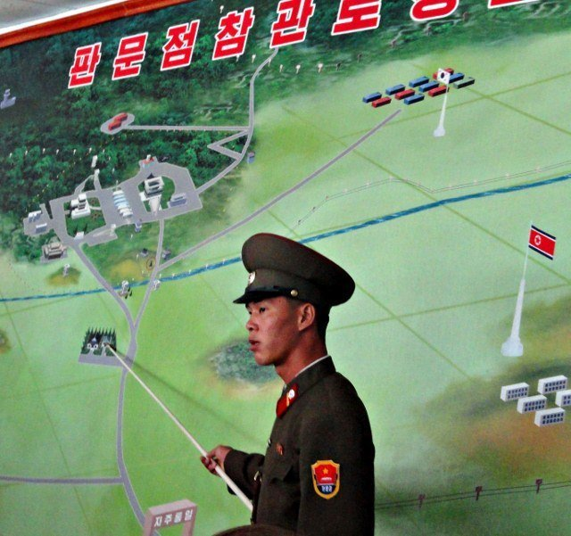 Military briefing by North Korean soldier at the DMZ.