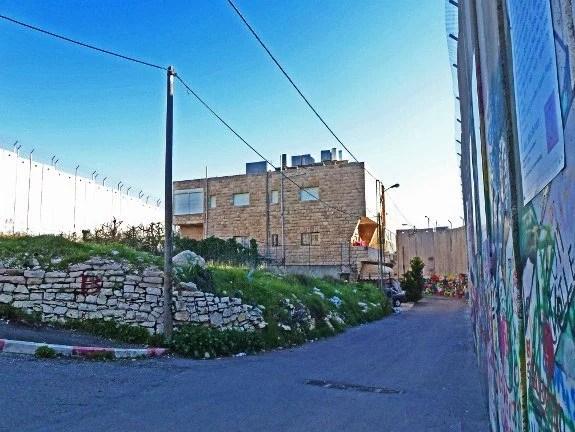 Israeli defense wall house surrounded