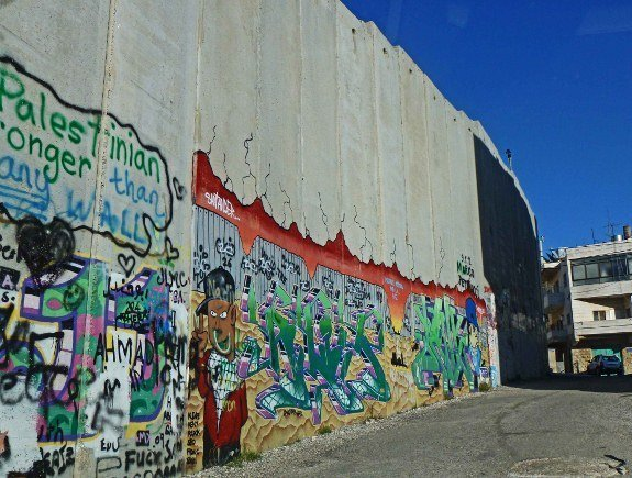 murals on security wall in israel