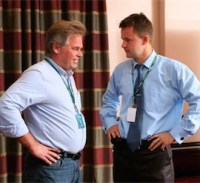 Kaspersky Lab founder and CEO Eugene Kaspersky (left) speaks with now-former CTO Nikolay Grebennikov at a 2011 analyst event.