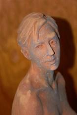 Sculpture, Woman seated on heels, head detail