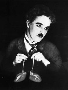 http://i1.wp.com/www.charliechaplin.com/images/film/poster/0000/0002/big_gold_rush_dance_of_the_rolls.jpg?resize=235%2C313