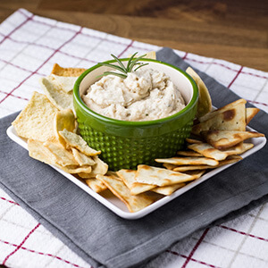 This rosemary-garlic cannellini bean dip is like supercharged hummus. It's so easy to make, and it's best served warm with crackers or vegetables!   recipe from Chattavore.com