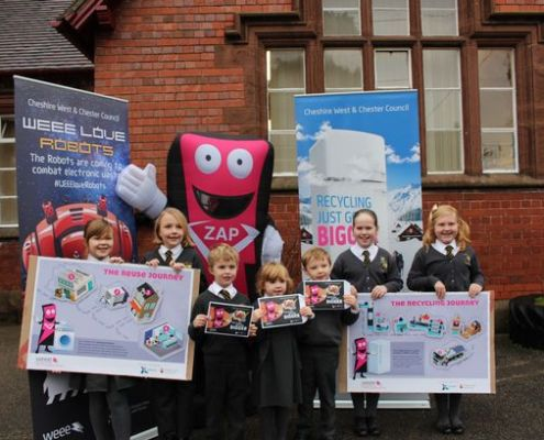 Saighton Primary School pupils Alicia Wright, Alisha Buckley, Poppy Taylor, Eva Prince, Corben Prince, Sid Campbell and Beau Campbell with ZAP the WEEE superhero