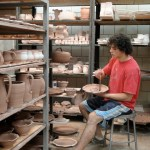 17. Joel-Cherrico-Pottery-at-The-Local-Blend-Brushing-Iron-onto-a-glazed-pot1