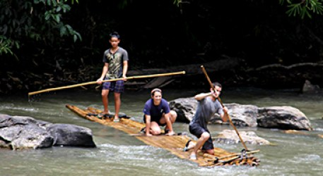 Rafting on handmade bamboo rafts down a local river
