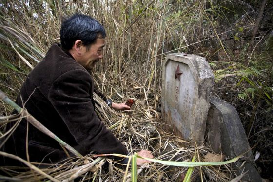 Guo Yimin finally finds the tombstone of his fallen comrade at a 30-year-old martyrs cemetary in Guangxi, China