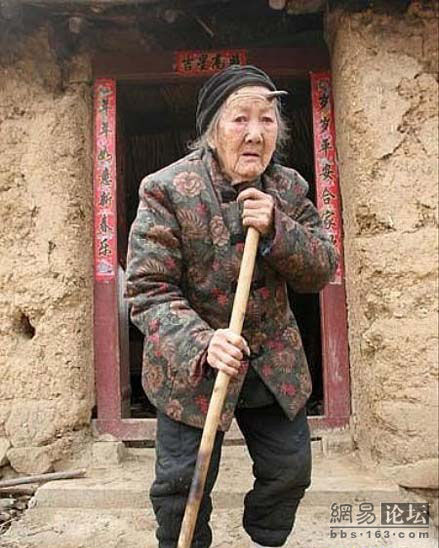 Henan, China, 101-year-old Zhang Ruifang sweeping the ground.