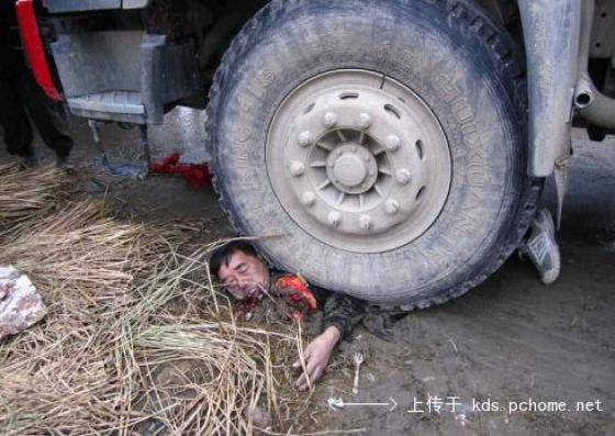 Zhaiqiao village head Qian Yunhui crushed underneath a truck tire.