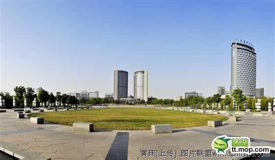 An impressive government building and park in China.
