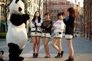 A panda and girls wearing panda shorts.