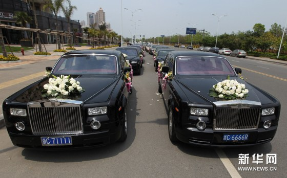 A pair of black Rolls Royche Phantoms at a Wenzhou, China wedding.