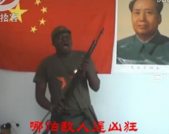 "An African man named ""Brother Hao"" sings a Chinese Revolutionary-Era propaganda ""red"" song to honor the Chinese Communist Party's upcoming 90th anniversary"