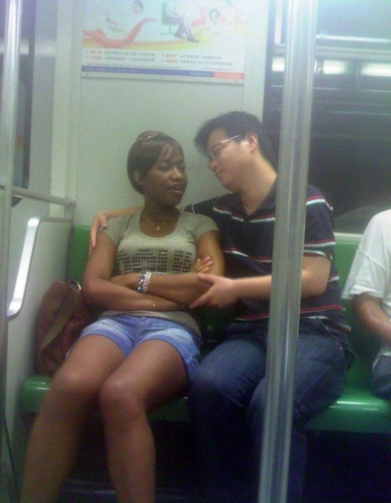 A Chinese and black couple on the Shanghai subway.