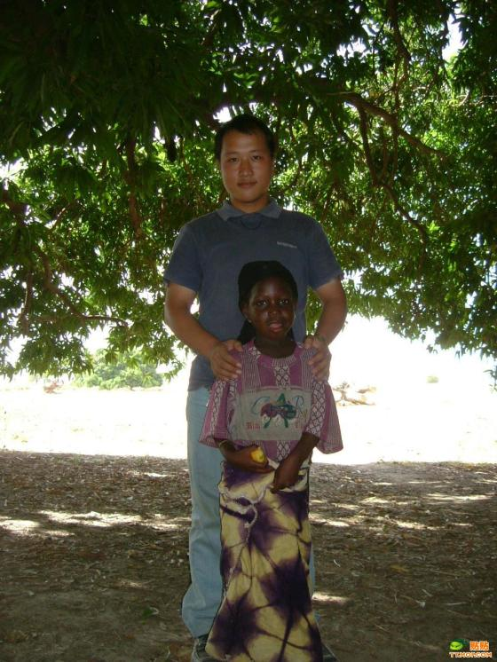 A Chinese man with his multiracial daughter.