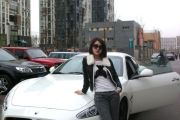 Guo Meimei and her Maserati sports car.