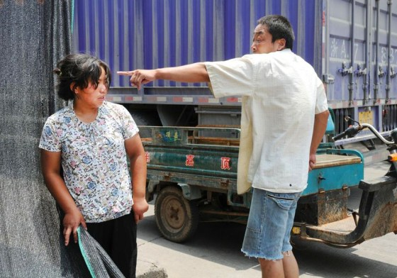 A Chinese migrant worker threatening his wife with further violence if she continues to disobey him.