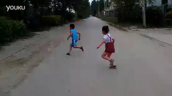 The little Chiense girl chasing her cousin.