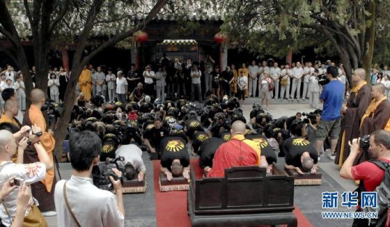 US Shaolin Fist students kowtow to Abbot Shi Yongxin of the Shaolin Temple during their visit.