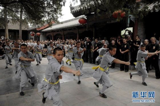 Warrior monks of the Shaolin Temple put on a performance for tourists.