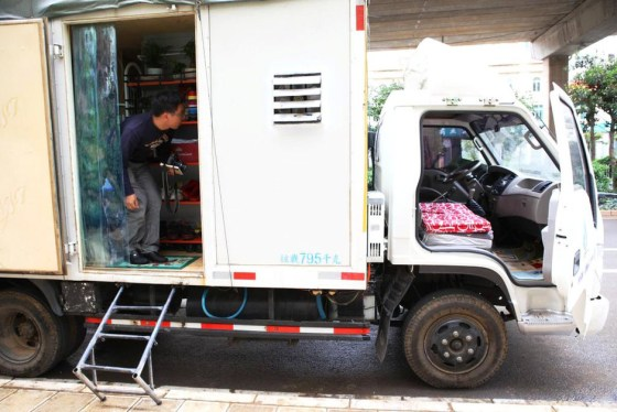 Kunming Chinese couple convert cargo truck into mobile home.