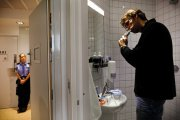 An inmate is brushing his teeth in the bathroom inside one of the single-person prison cells build with various amenities in the luxurious Halden Fengsel, (prison) near Oslo.