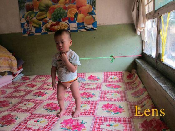 A Chinese foster child who is tied to a bed.
