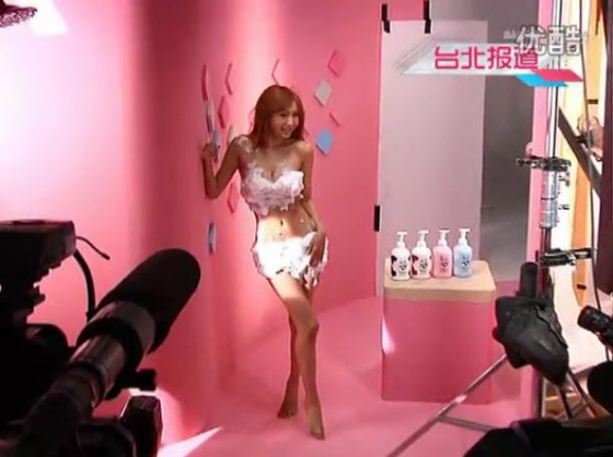 Japanese-Taiwanese actress and singer Kawashima Makiyo poses nearly nude to advertise a shower gel.