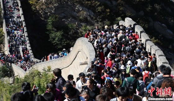 Crowds of visitors at major tourist sites during China's National Day holiday.