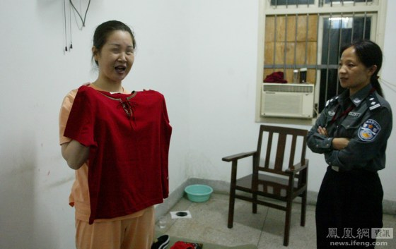A Chinese woman sentenced to death tries on new clothes on the eve of her execution.