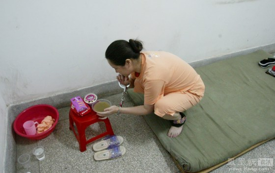 A Chinese woman sentenced to be executed the next day eats a bowl of green mung bean soup.