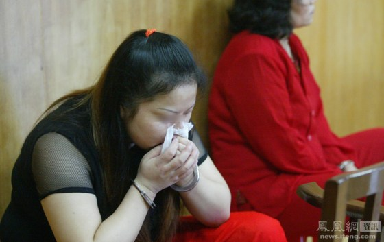 He Xiuling, a condemned woman prisoner breaks down and cries as her execution nears.