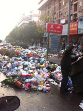 Garbage piled on the streets of Nanjing due to protests by the city's sanitation workers.