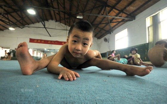 Little boys in China undergoing gymnastics training.