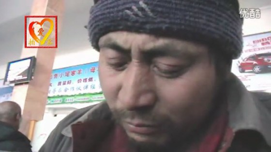 A Chinese migrant worker in tears overcome with emotion at the prospect of being able to go home for Chinese New Years.