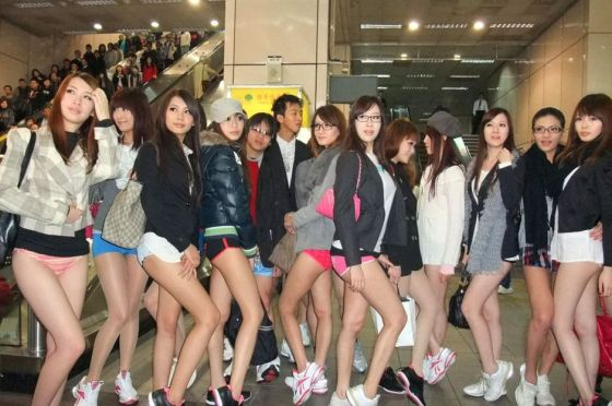 "Taiwanese girls flaunt their assets in a mock ""No Pants Subway Ride"" meant to raise awareness about carbon emissions and energy conservation in Taipei"