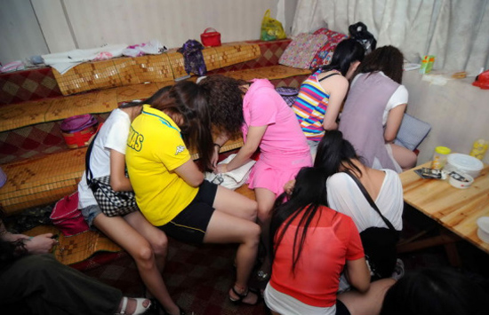 Chinese prostitutes hiding their face from the camera.