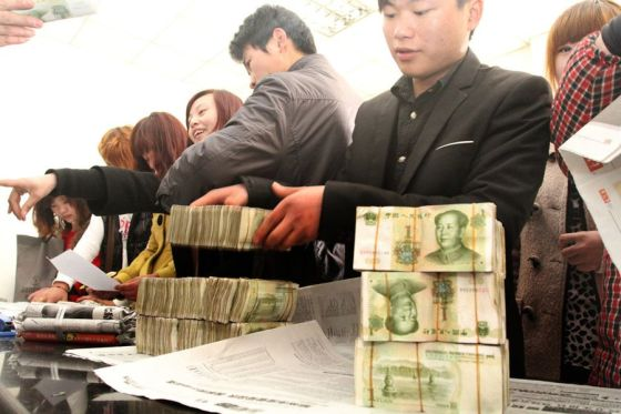 A Chinese public bus transportation company pays its employees and workers with bundles of 1 RMB money notes and 1 RMB coins because the bank refuses to deposit such loose change.