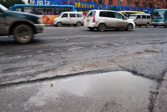 In Kaili city of Guizhou province in China, a two month old paved asphalt road is already crumbling and disintegrating.