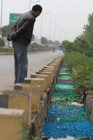 A Henan ditch is filled with millions of illegally dumped but colorful empty medicine capsules.
