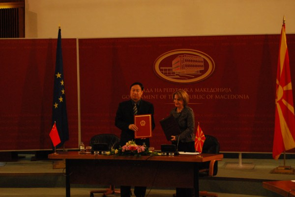 Chinese ambassador Cui and Macedonia Deputy Prime Minister Arifi at a ceremony for the donation of 23 school buses from China to Macedonia.