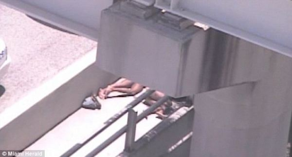 The naked legs of a man who was shot dead by police in an apparent case of public cannibalism in Miami.