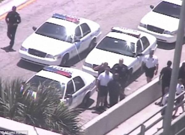 Miami police on the scene where a naked man was shot dead by police for eating another man's face.