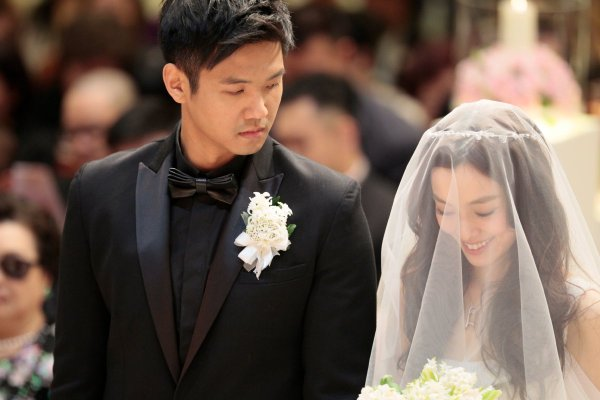 Christine Fan and her husband at the wedding