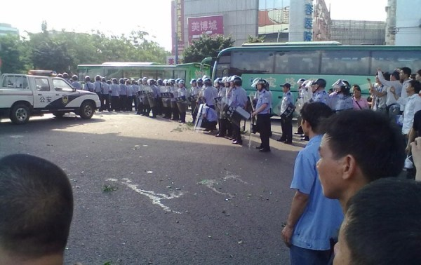 Black Africans in Guangzhou assemble on a street to protest the suspicious death of a man in police custody.
