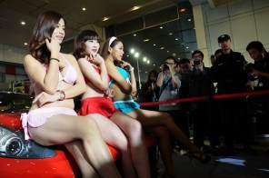 The mothers of the little girls, also wearing bikinis as part of a mother-daughter modeling competition at a Wuhan auto show.