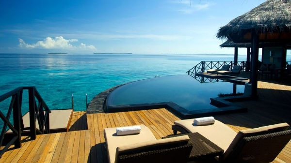 Beach House Irevuli, Maldives. Pool by the sea.