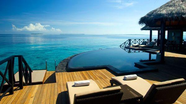 Beach House Irevuli, Maldives. Pool by the sea.