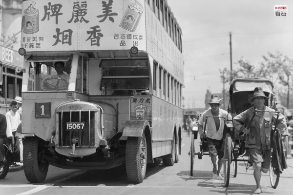 """In the 1930s and 1940s of the 20th century, Shanghai's advertising and media industry had already developed to a very high level, yet another piece of evidence of Shanghai's flourishing commercial trade at the time. Photo is of the Shanghai Bund in 1935, where public buses were """"invaded and taken over"""" by all types of advertisements. Corbis"""