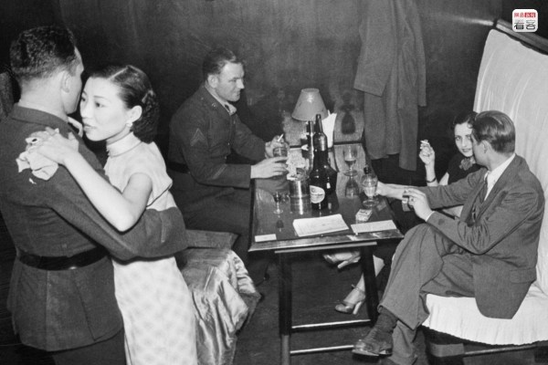 Photo is of not long after the end of the War of Resistance, of a dancing girl and a soldier dancing. There were still many foreign soldiers in the bars. Shanghai became an international city where foreigners could be seen everywhere. Corbis